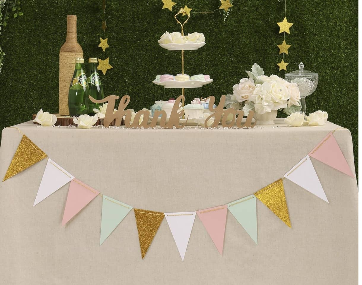 baby shower table set up with pennant banner and desserts