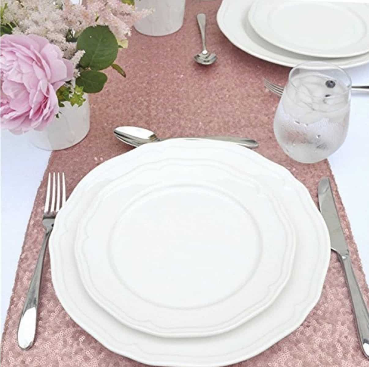 baby shower table set up with sequin table runner and white china