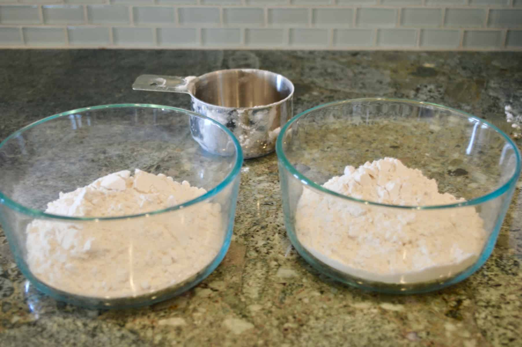 two bowls with flour on a counter
