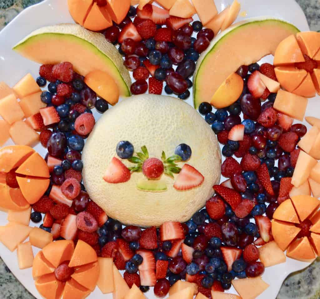 Funny Bunny Fruit Platter makes it ok to play with your food! Kids and adults will love this cute bunny fruit platter. #easter #fruitplatter #brunch #breakfast #cantaloupe #berries #kids #parenting