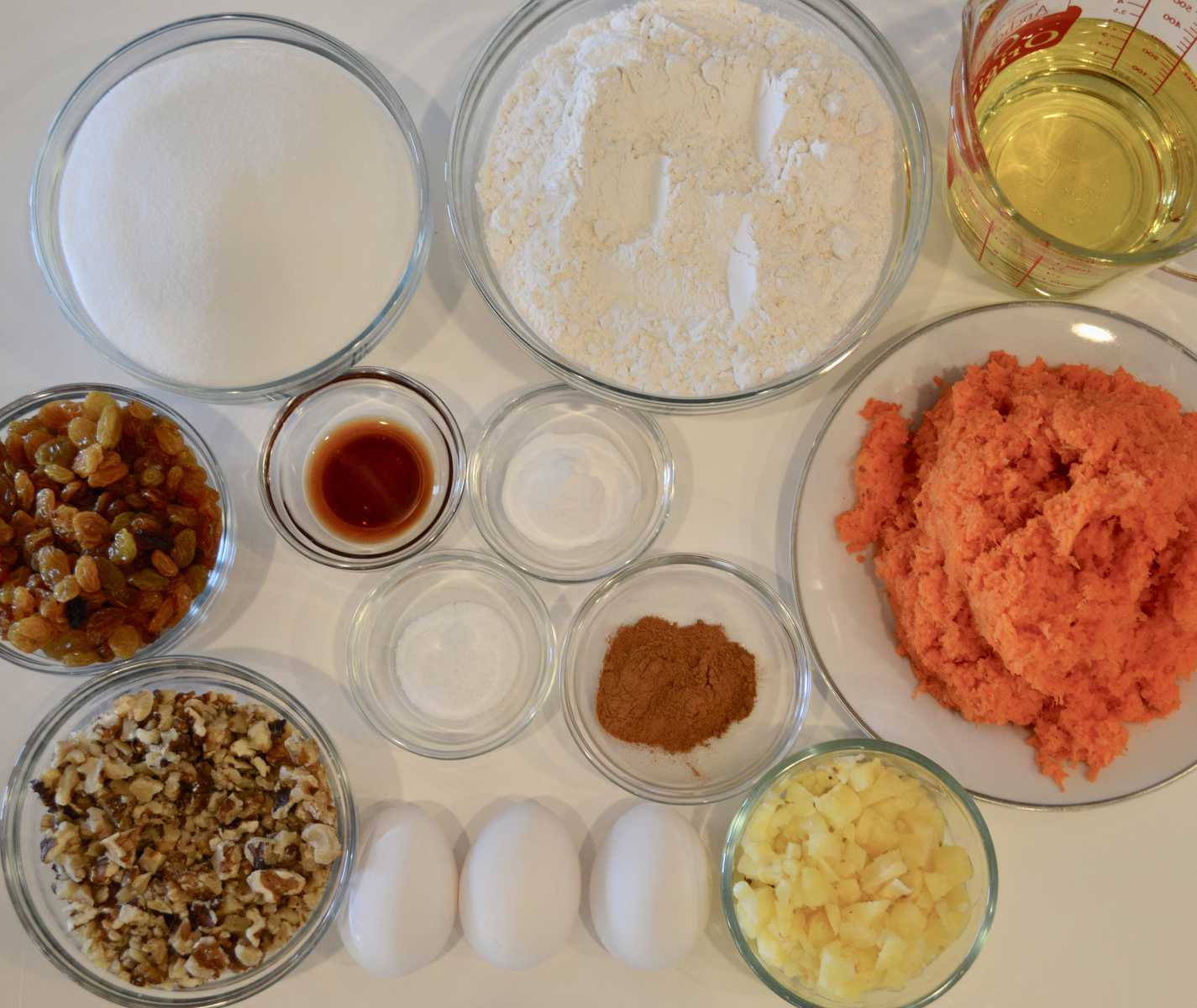 Ingredients for Carrot Pineapple Cake on a white background