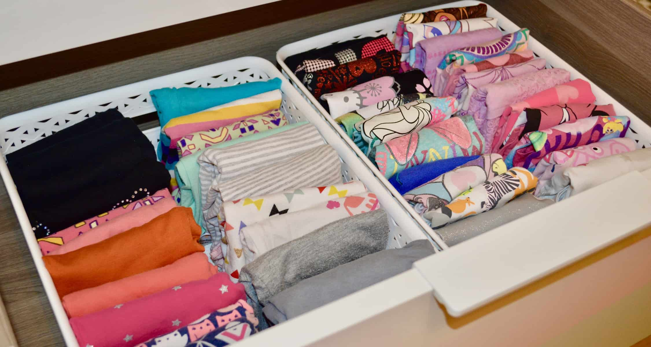 neatly organized dresser with well folded vertically stacked girls clothes