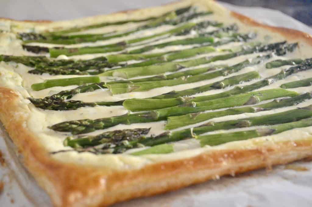 Asparagus Tart with Ricotta and Lemon is made with puff pastry and is an easy recipe for an appetizer or side dish. Best Brunch Recipes. Great party food for baby or bridal showers, or served on the holidays. #asparagus #tart #ricotta #puffpastry #thanksgivingsidedish #christmassidedish #easter #appetizer #partyfood #appetizerforparty #easyrecipe #brunch #breakfast
