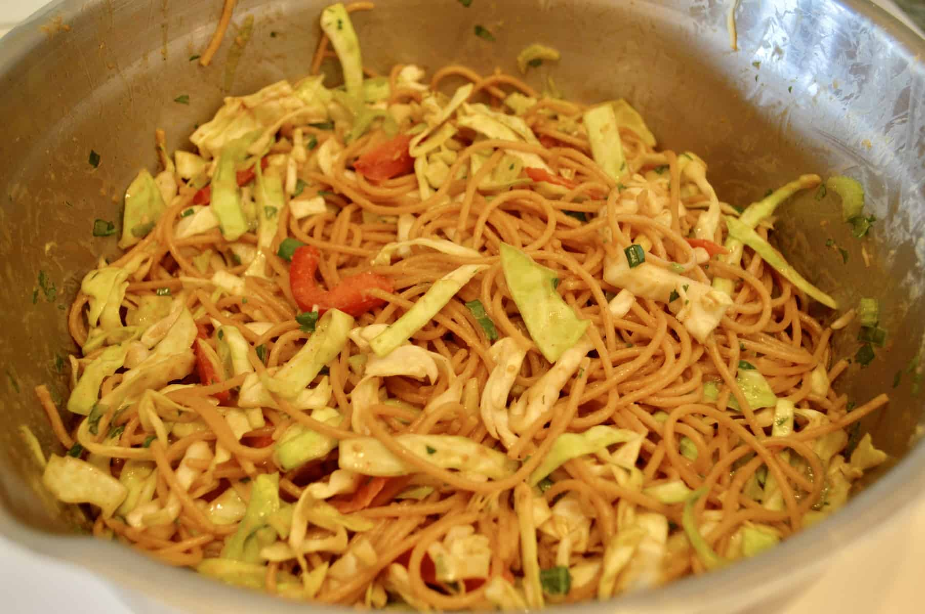 Asian Noodle Salad is an easy recipe using whole wheat spaghettini, cabbage, bell peppers, soy sauce, and peanut butter. Meal prep lunches and great side dish. #asian #noodle #salad #mealprep #healthy #sidedish #vegetarian #vegan #healthy #pastasalad