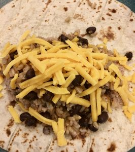 mixture placed in the middle of the tortilla.