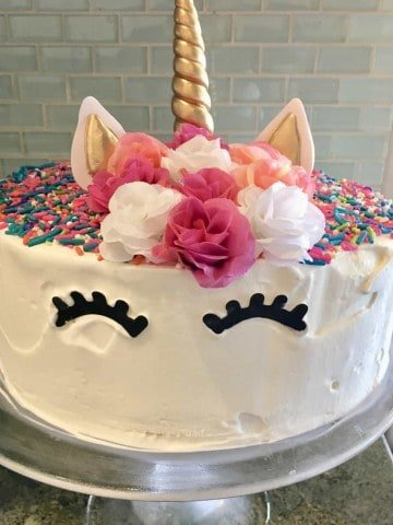 Unicorn Ice Cream Cake is an easy recipe that is a copycat of Dairy Queen. This recipe is homemade using whatever ice-cream you want, Oreos, fudge sauce, and sprinkles. #icecreamcake #dairyqueen #copycat #easy #recipe #homemade #unicornbirthdayparty #unicorn #birthdayparty #birthdaycake #oreos #sprinkles #fudge #parenting #kids #stepbystep