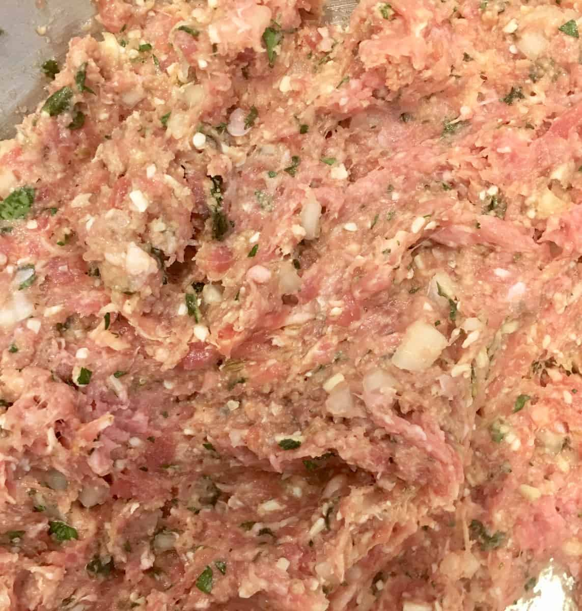 close up of raw meat for the turkey meatballs.