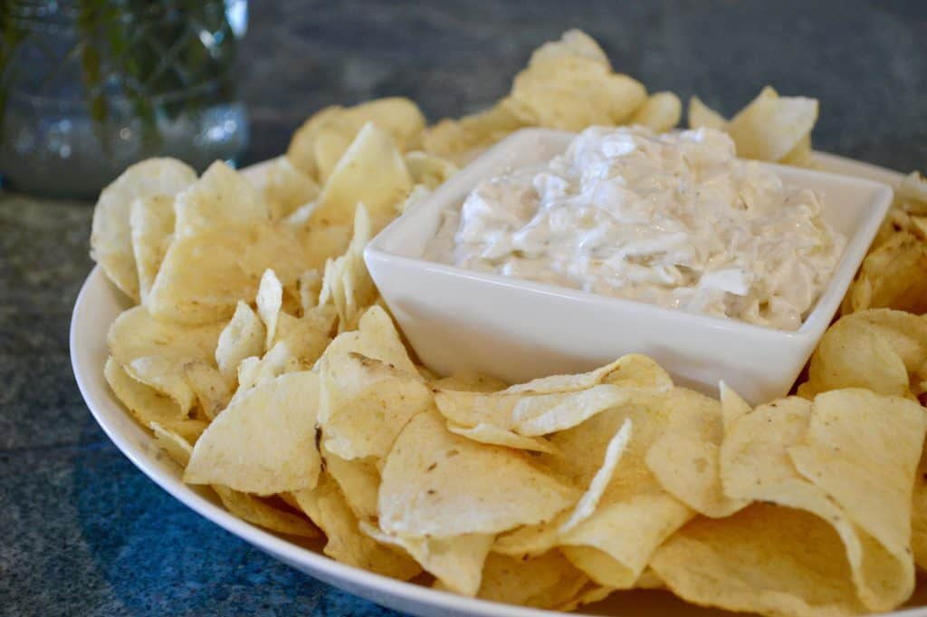 Caramelized Onion Dip is a great appetizer for barbecue bbq, brunch, or football game day snack. Easy to make ahead and so delicious! Serve with chips, veggies, or on crackers. #oniondip #caramelizedonions #dip #footballrecipes #gameday #tailgating #bbq #sidedish #veggiedip #chipdip
