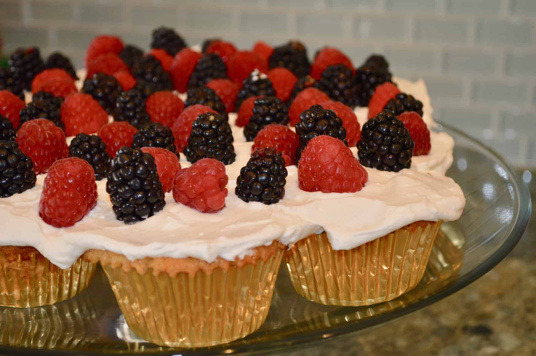 Pull-Apart Vanilla-Wafer Cupcakes with mixed berry topping on a glass pedestal