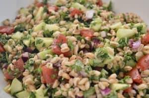 farro tabbouleh salad in a white bowl.