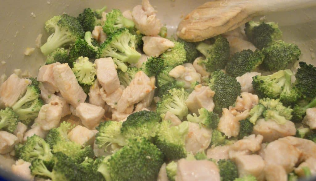 Chicken and broccoli cooking on the stovetop