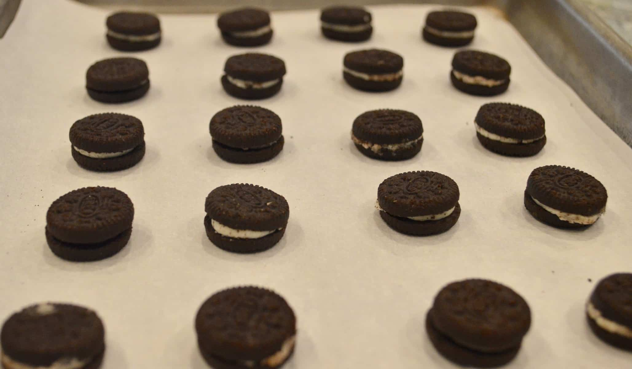 Mini oreos on a pan with parchment paper