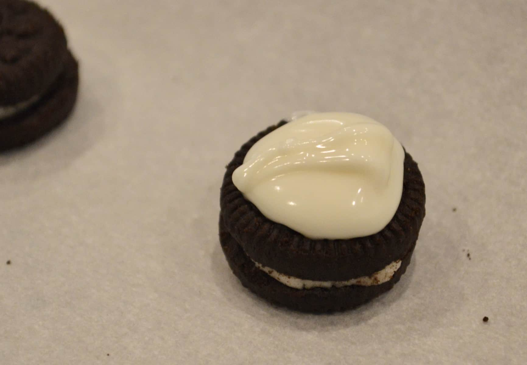 mini oreos topped with white chocolate