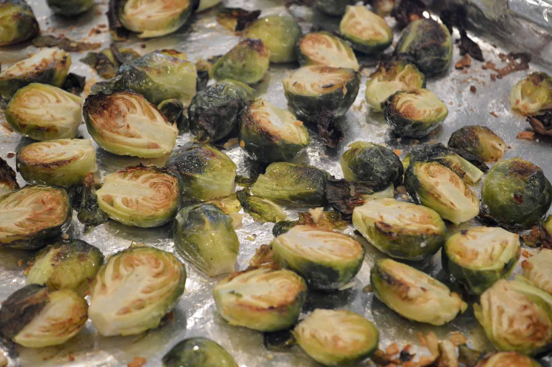 roasted Brussels sprouts with garlic out of the oven on a sheet pan