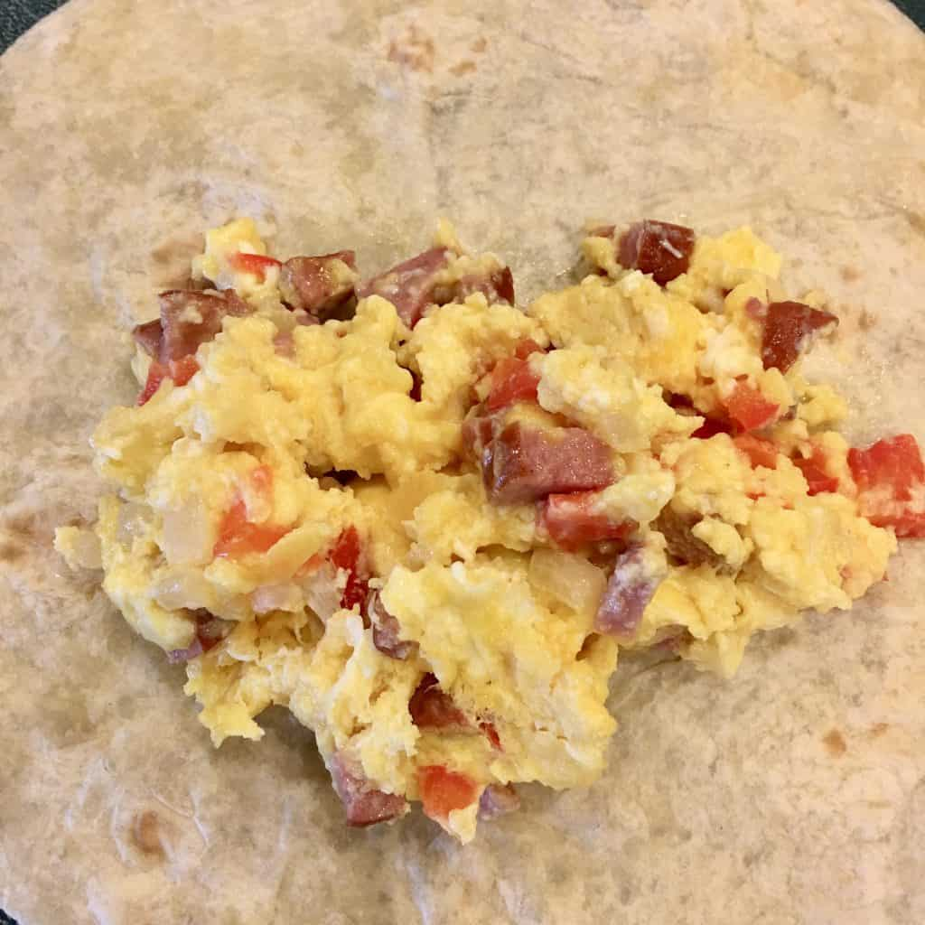 egg mixture in the middle of a tortilla.