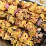 Grilled Chicken Kabob Skewers with lemon, garlic, paprika, oregano and turmeric. Skewered with bell peppers and red onions.