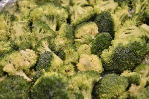 Oven Roasted Broccoli with Garlic is an easy side dish you bake in the oven. Roasted broccoli is a healthy way to serve veggies and is easy to make with little clean up. #broccoli #roastedbroccoli #garlic #sidedish #weeknightdinner #easyrecipe