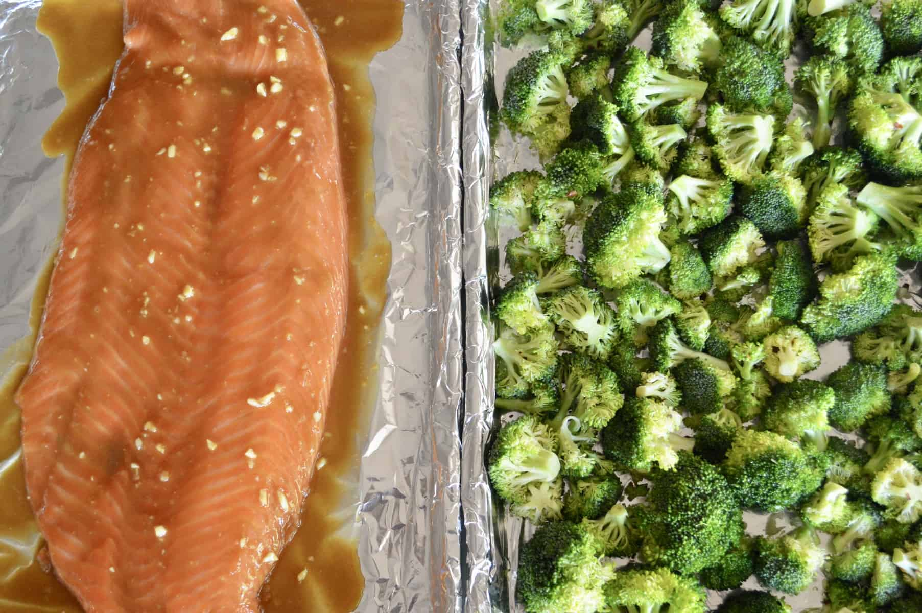Meal Prep Salmon and Broccoli baked on foil sheet pans