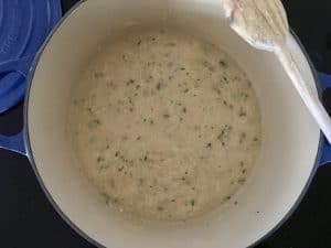 sauce with butter, parmesan, and thyme in a pot.