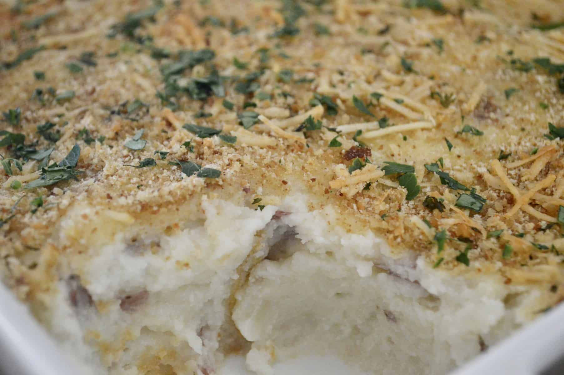 Mashed potato casserole with parmesan and breadcrumb topping