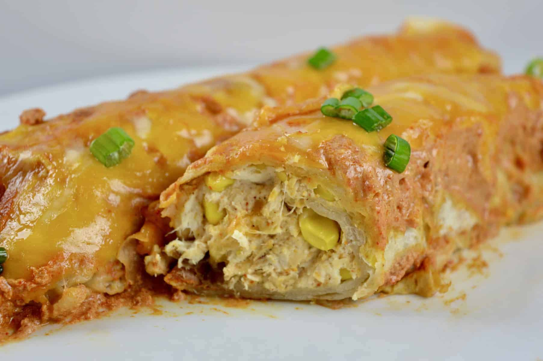 plate of enchiladas with chicken and corn
