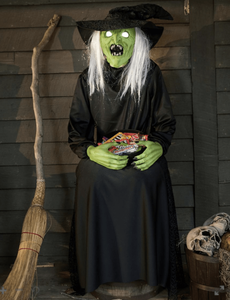 best outdoor halloween decorations including this sitting scare witch animatronic