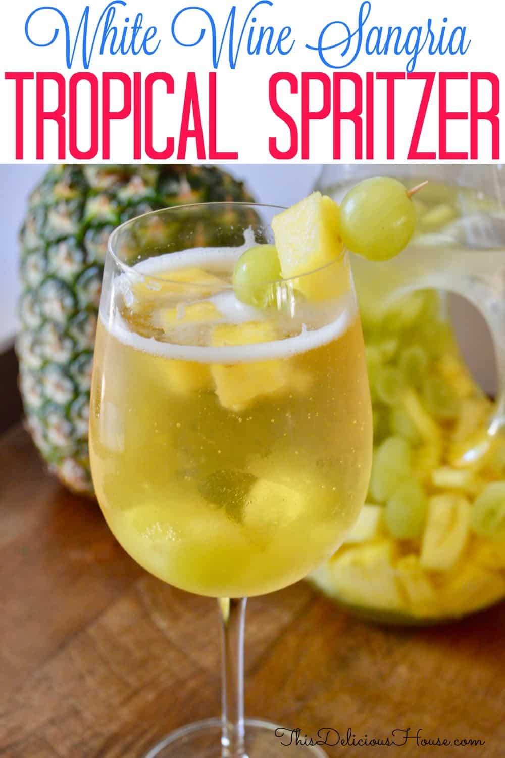 pintrest pin for tropical white wine spritzer.