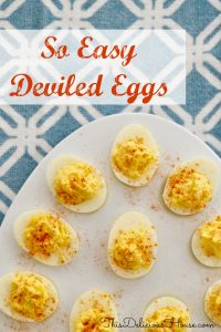 Deviled eggs on a plate with a blue and white background