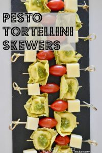 Pesto Tortellini Skewers with cherry tomatoes and provolone cheese on a bamboo skewer