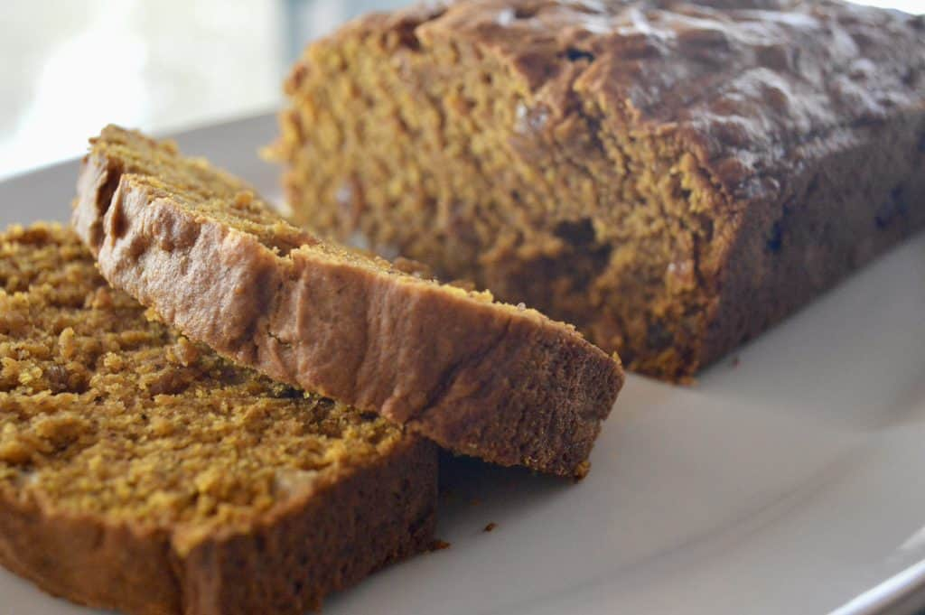 Pumpkin Walnut Raisin Bread is an easy pumpkin bread recipe that is moist and better than Starbucks! Best brunch recipes. #pumpkinbread #pumpkinloaf #fall #recipe #baking #walnuts #goldenraisins #easy #starbucks #healthy #pumpkin #brunch #fallgift #gifting #giftbasket