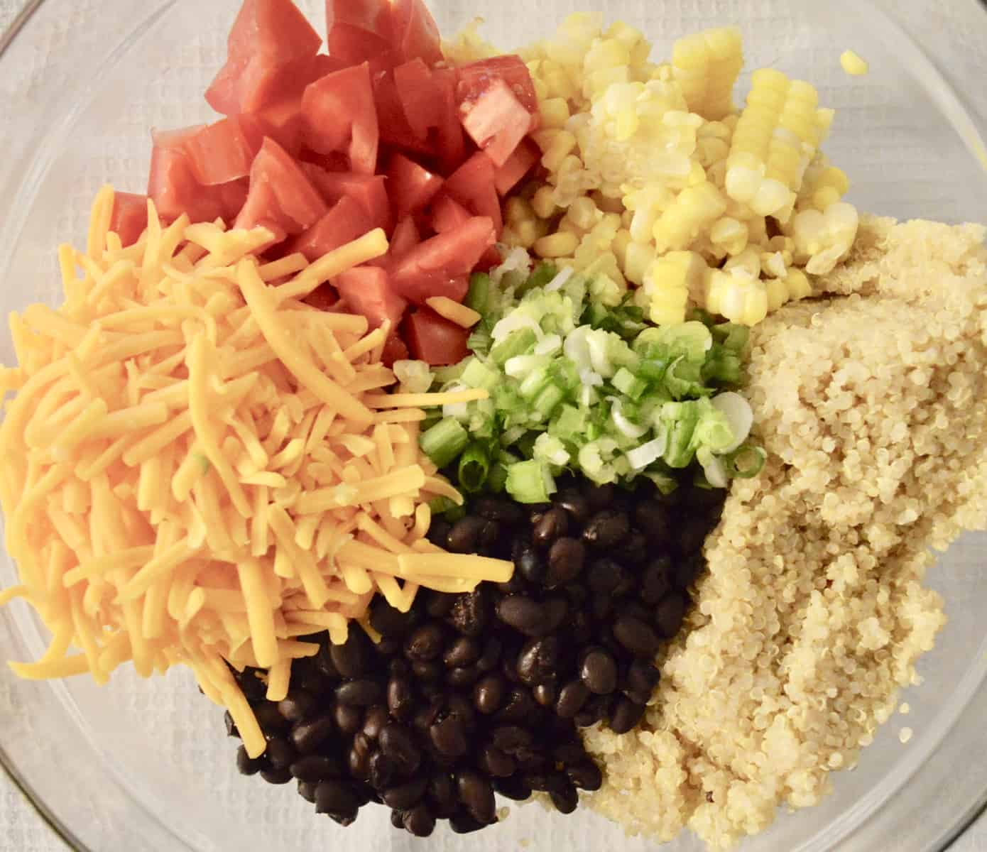 grains, black beans, corn, and cheese in a bowl