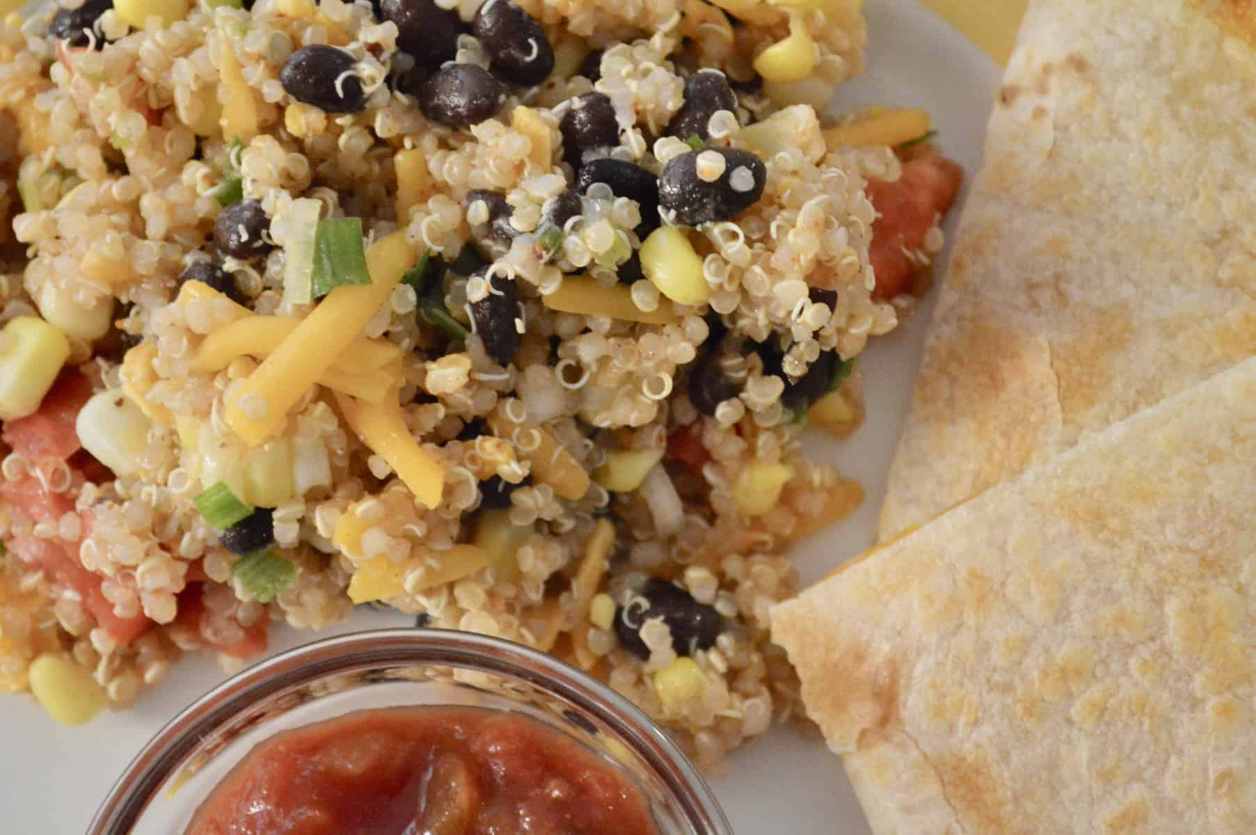 Mexican Quinoa with black beans, corn, tomatoes, and cheddar with a cheese quesadilla