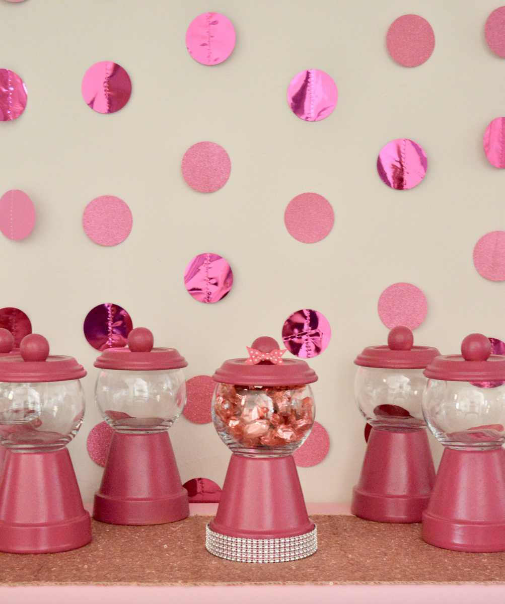 DIY Gumball Machine Party Favors set up on a pink table with pink backdrop