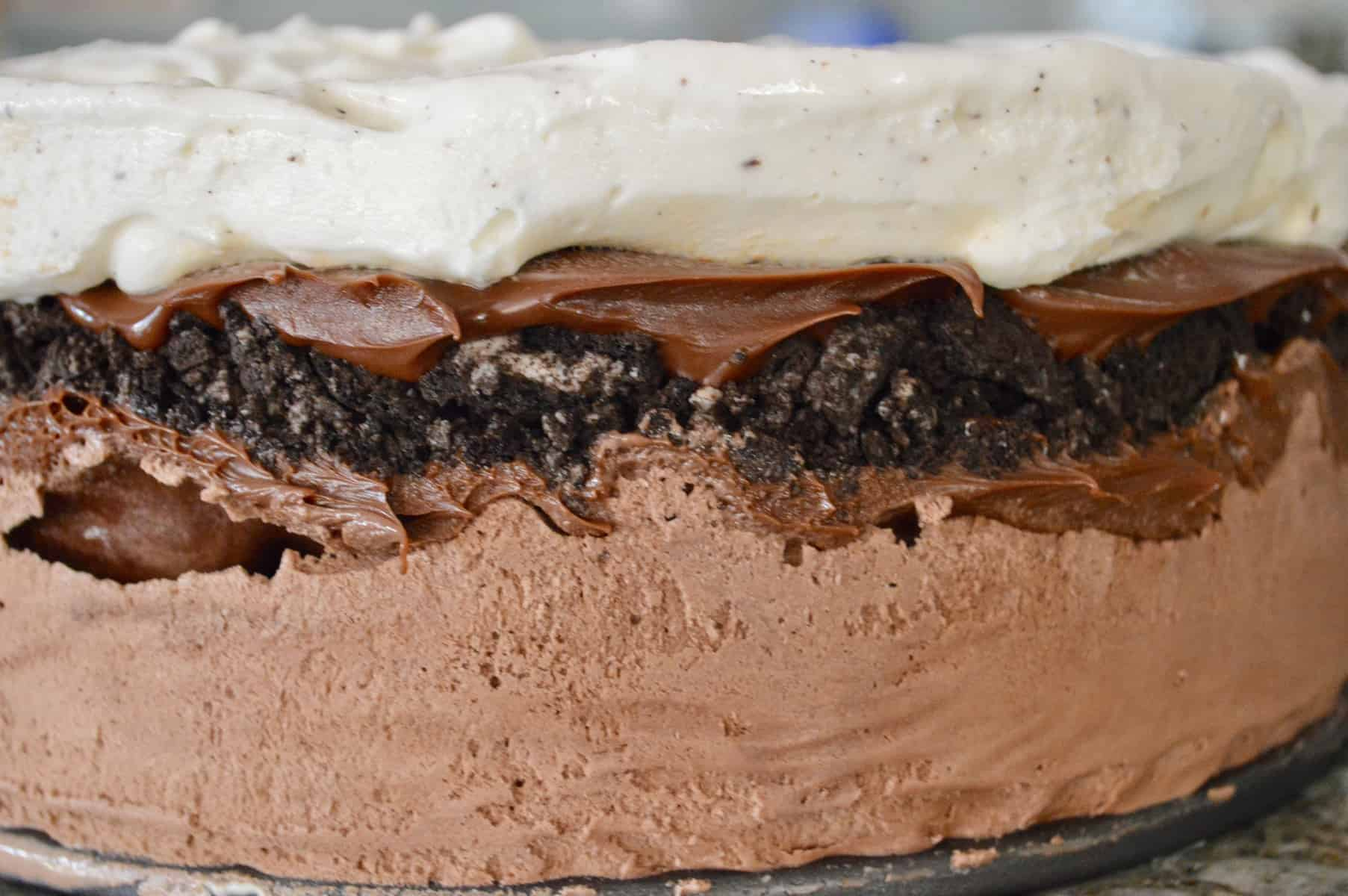 Easy Ice Cream Cake without frosting showing chocolate, fudge, oreos, and vanilla layers
