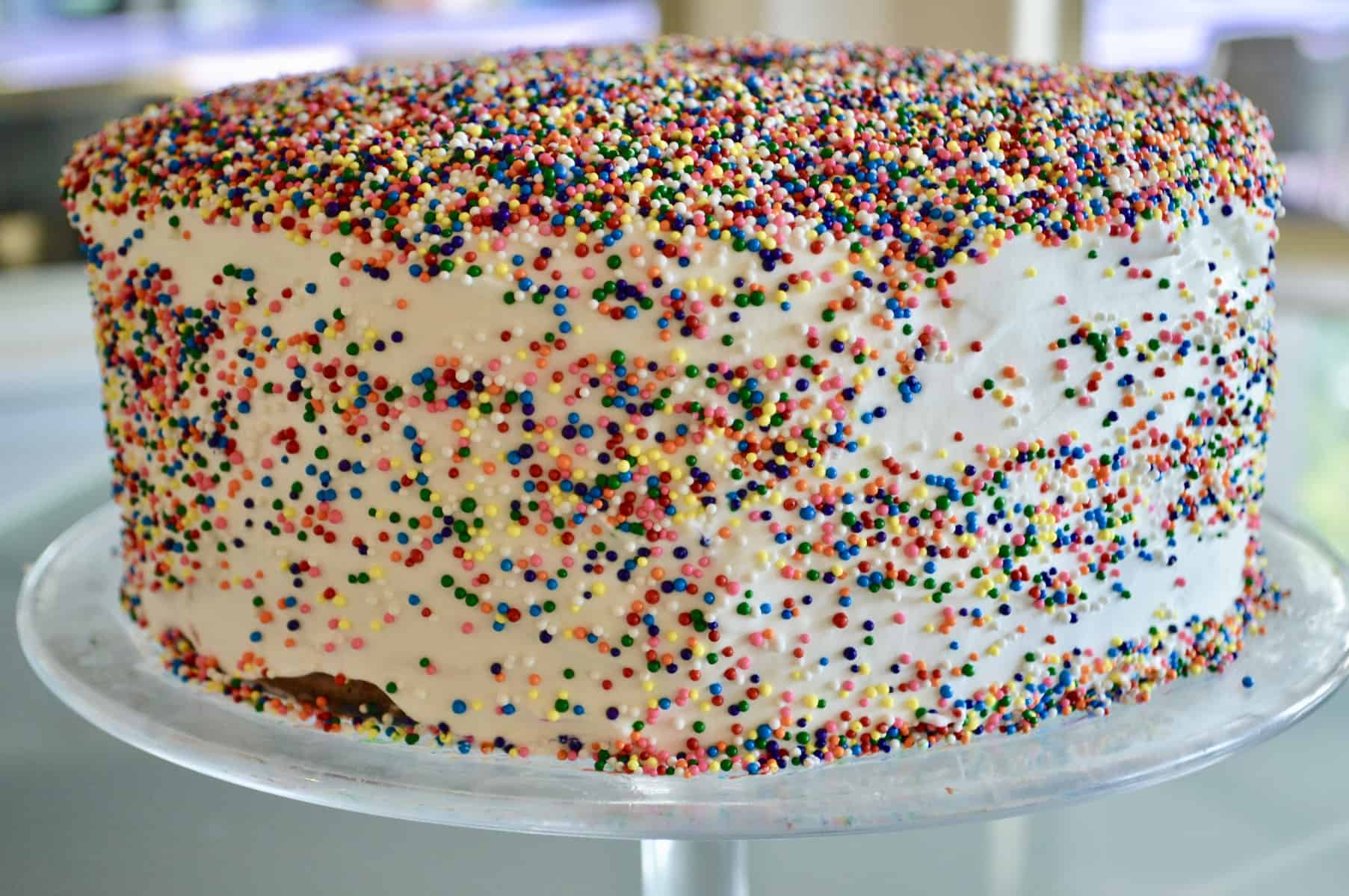 Easy Ice Cream Cake with sprinkles on a glass pedestal