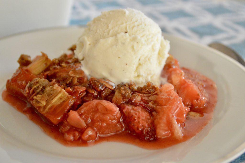 Strawberry rhubarb crisp with vanilla ice cream on top