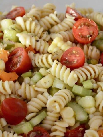 Pasta Salad with Veggies and Corn in a white bowl