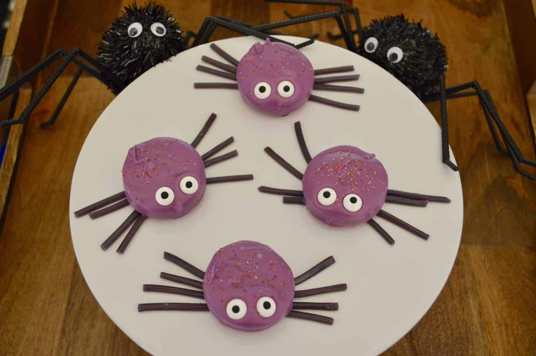 Purple candy coated oreo cookie spider with Twizzler legs