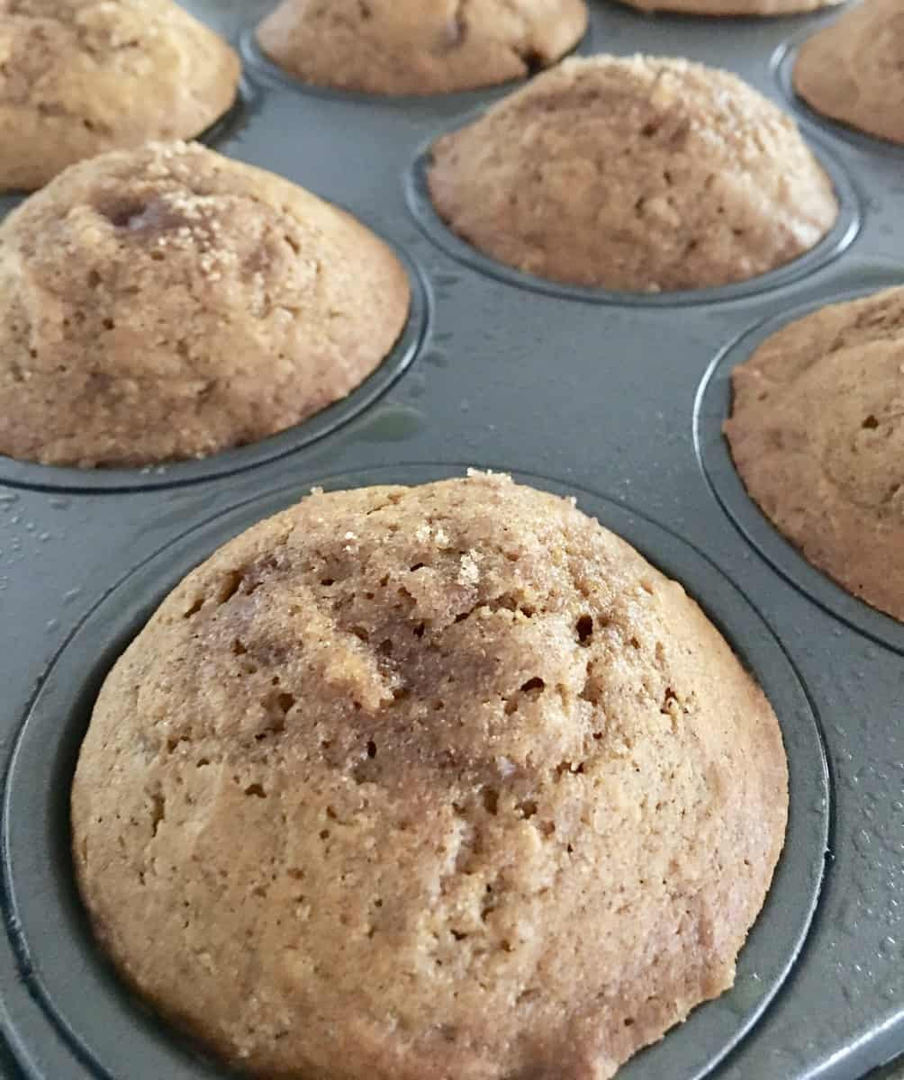 Pumpkin muffins in a muffin tin fresh out of the oven