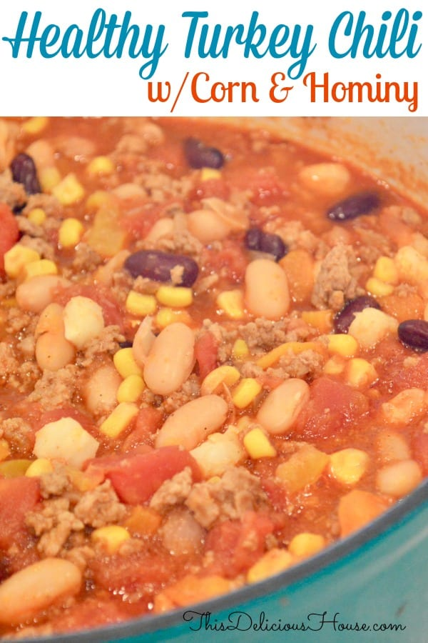 Healthy Turkey Chili with Corn and Hominy in a blue dutch oven