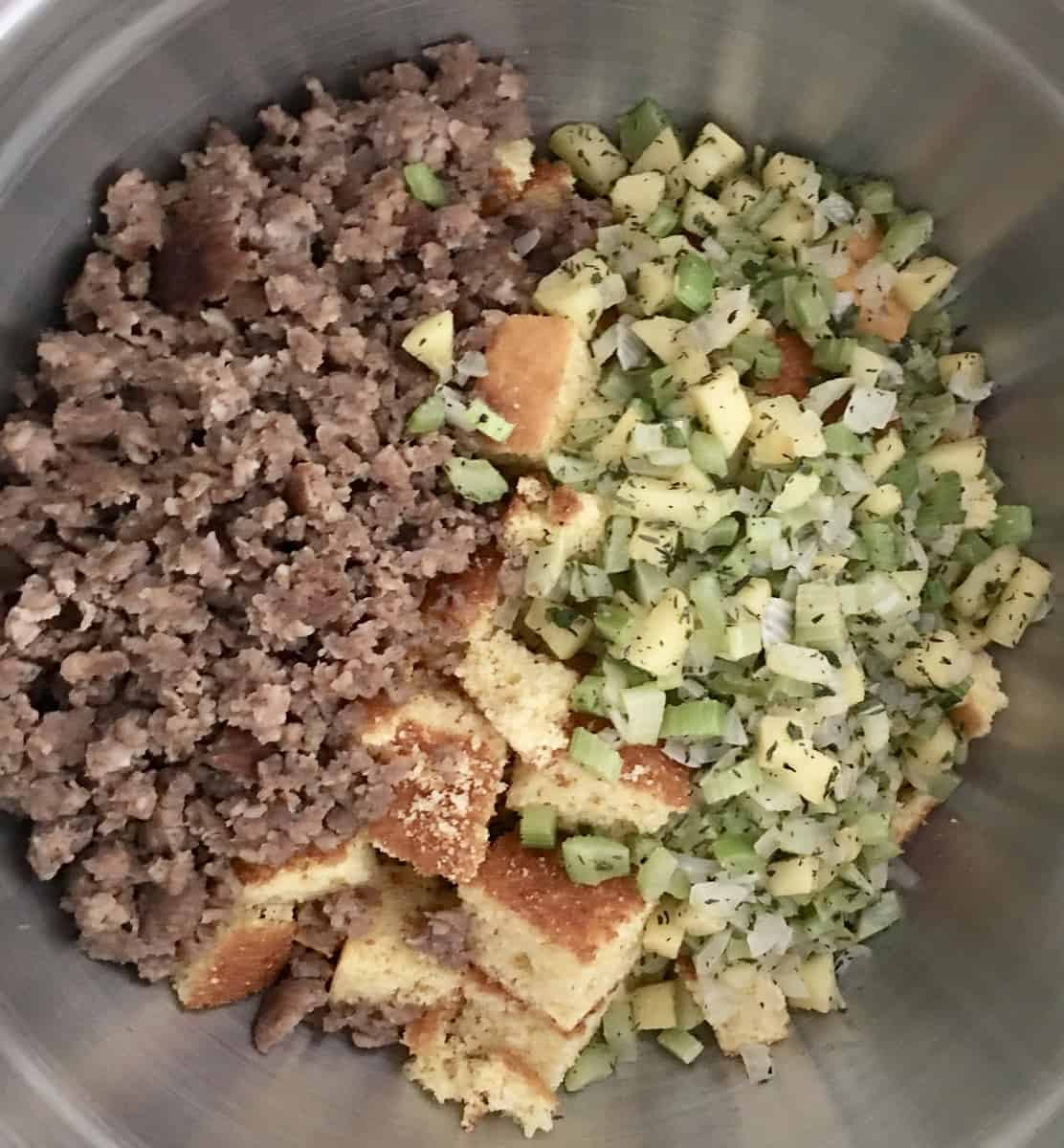 sausage, cornbread, and veggies in a bowl for make-ahead cornbread stuffing.