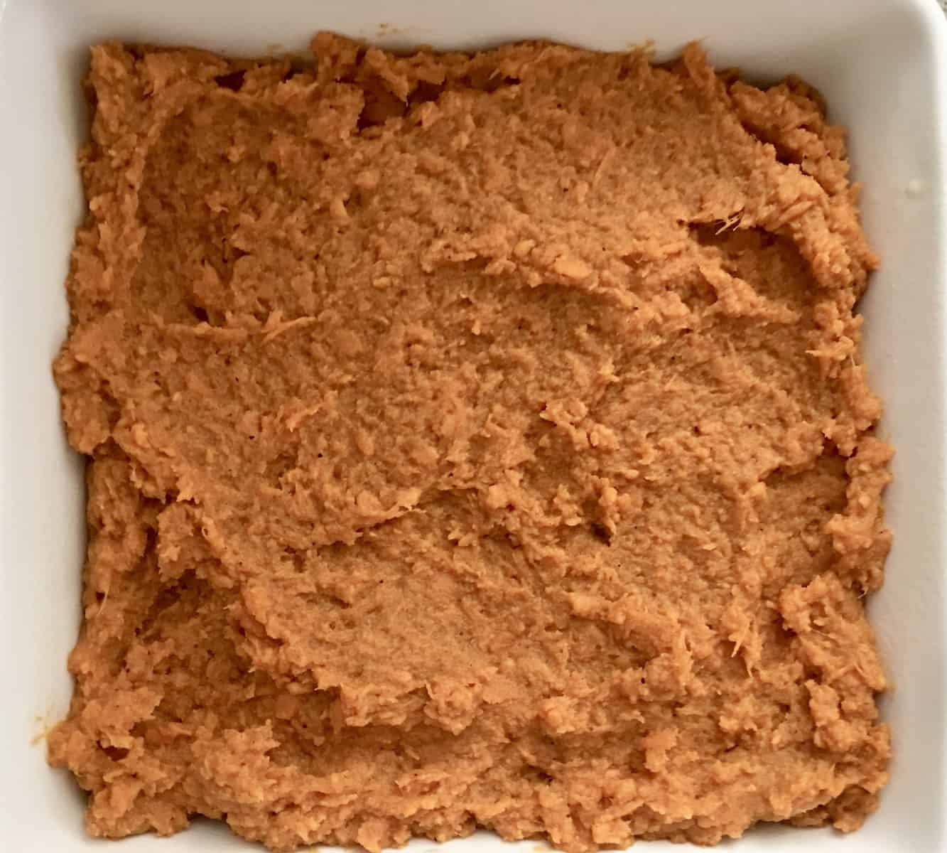 mashed sweet potatoes spread in a baking dish