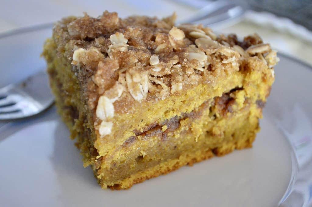 pumpkin streusel coffee cake slice on a white plate