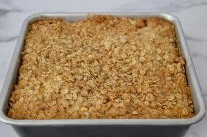 pumpkin streusel coffee cake in a baking pan.