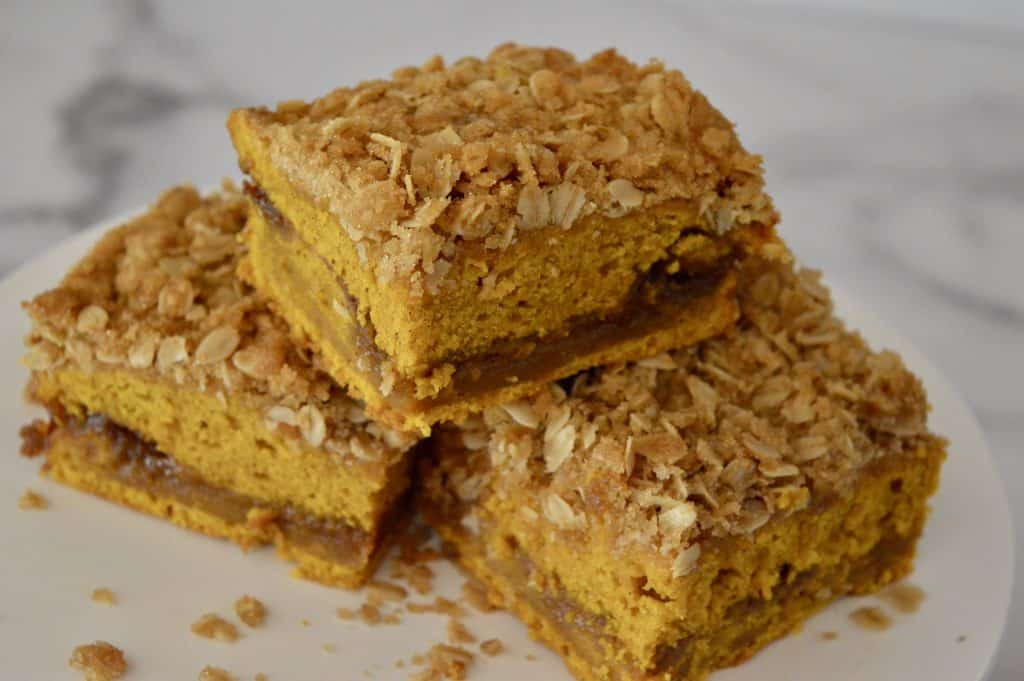 pumpkin streusel coffee cake on a white platter.