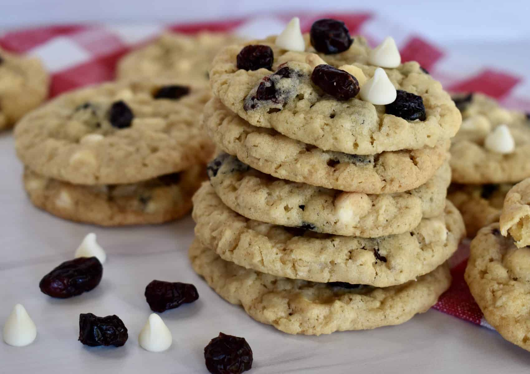 White Chocolate Cranberry cookies stacked on each other.