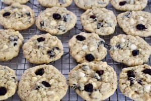 White Chocolate Cranberry cookies cooling on a cooling rack.