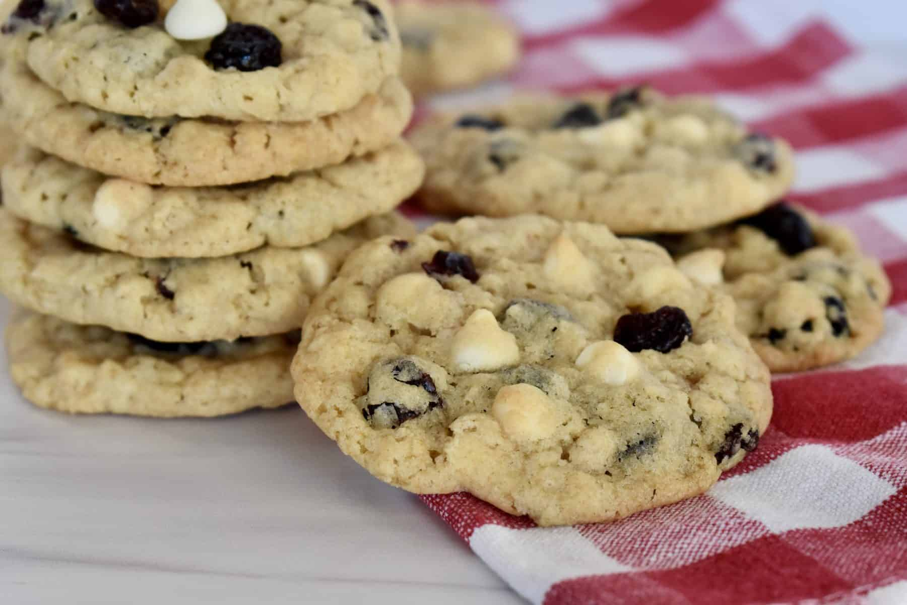Cranberry White Chocolate Cookie on a checkered napkin.