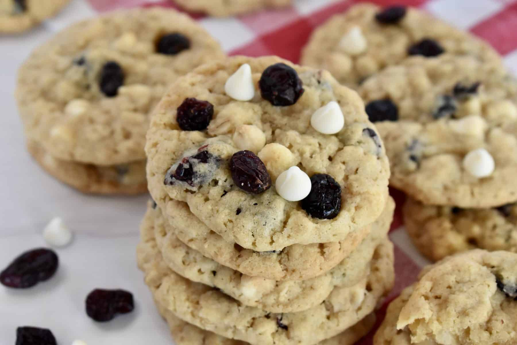 White Chocolate Cranberry Cookies stacked on a plate.