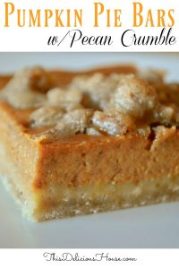 pumpkin pie bars with pecan crumble topping baked in a sheet pan